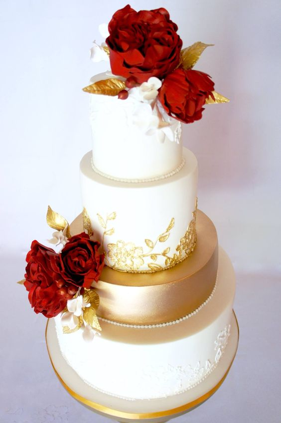 Red Flower Topped Gold And White Wedding Cake