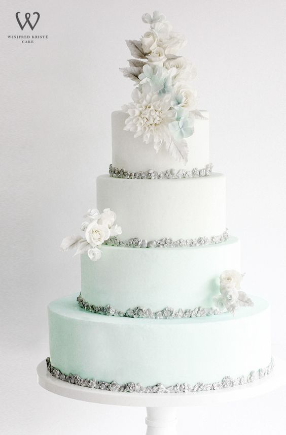 Light Blue And White Wedding Cake With Silver Design